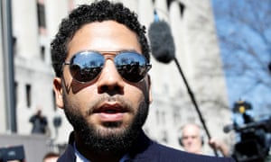 Actor Jussie Smollett leaves court after charges against him were dropped by state prosecutors in Chicago, Illinois