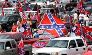 Hundreds of pro-Confederate flag and gun supporters rally at Stone Mountain Park.