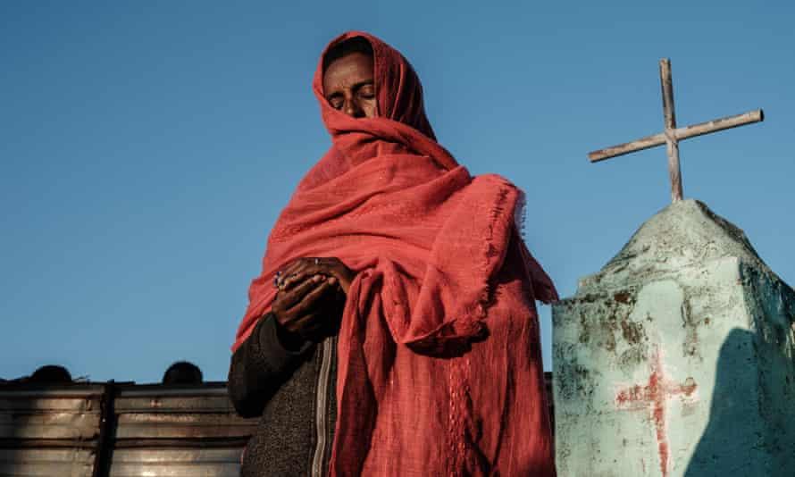 A female Ethiopian refugee prays at a church near Um Raquba  camp in neighbouring Sudan.