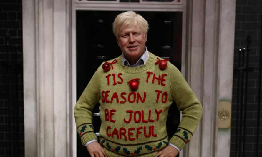 A figure of prime minister Boris Johnson wearing a Christmas jumper at Madame Tussauds, in London.