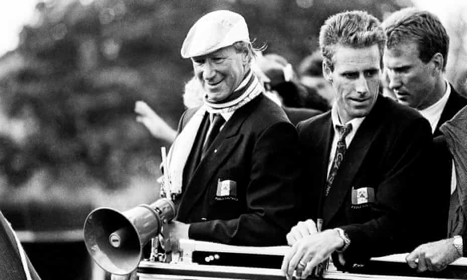 Jack Charlton and Mick McCarthy enjoy the open-top bus parade after Italia 90.