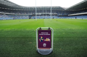 Edinburgh players train with a health warning sign at Murrayfield.