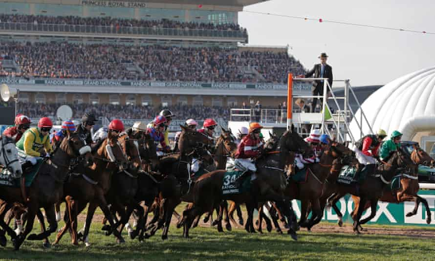 The start of the Grand National in 2019. Crowds will be absent at Aintree this year.