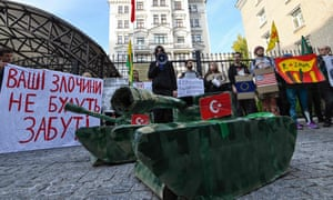 Demonstrators protest against the Turkish military operation in Syria, outside the Turkish embassy in Kiev.