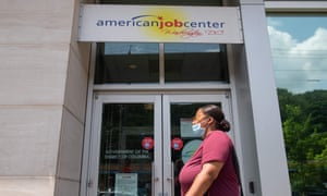 A woman walks past an employment center in Washington DC.