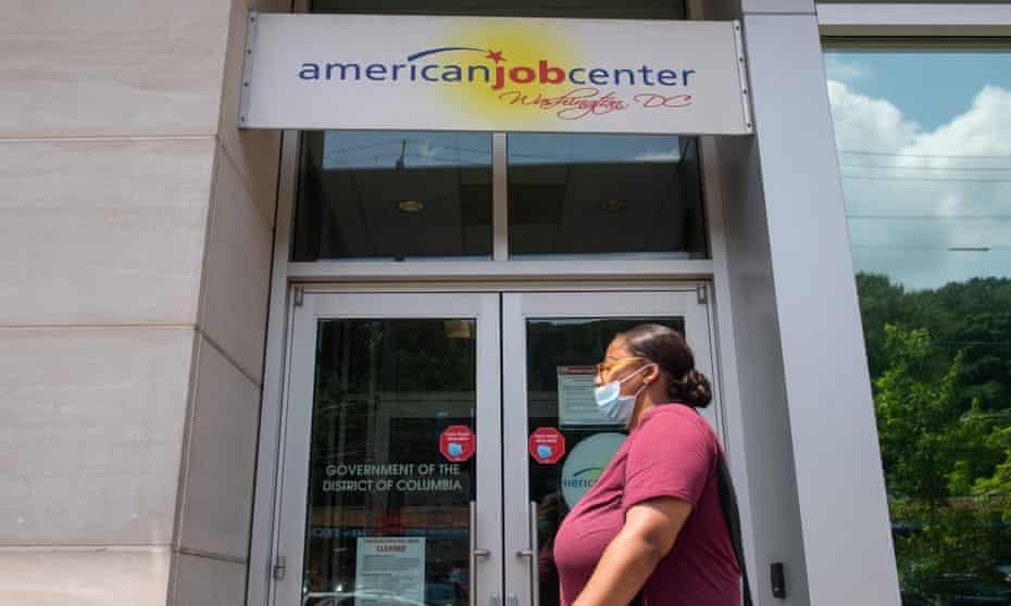 A woman walks past an employment center in Washington DC.