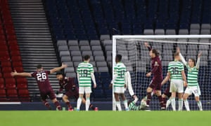 Josh Ginnelly celebrates after scoring Hearts' third goal.