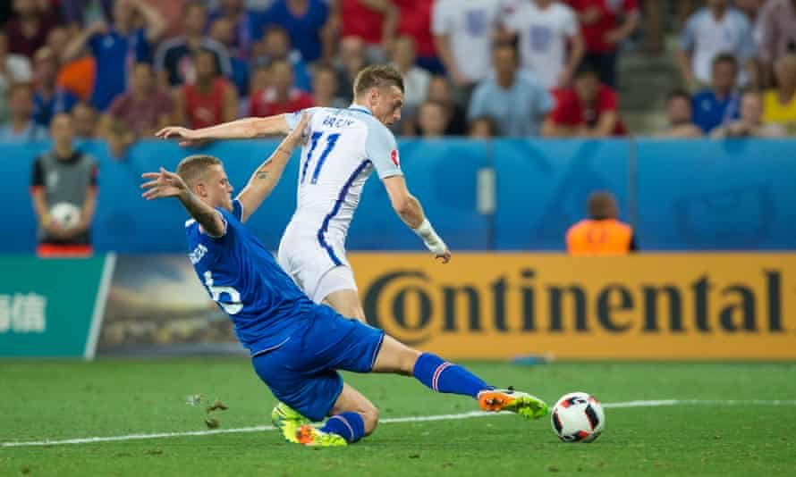 The England substitute Jamie Vardy is tackled superbly by Ragnar Sigurdsson late in Iceland's 2-1 victory at Euro 2016.