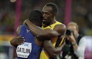 Usain Bolt embraces Gatlin after the men's 100m final.