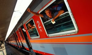 Italy, Rome, backpackers aboard train, view from platform