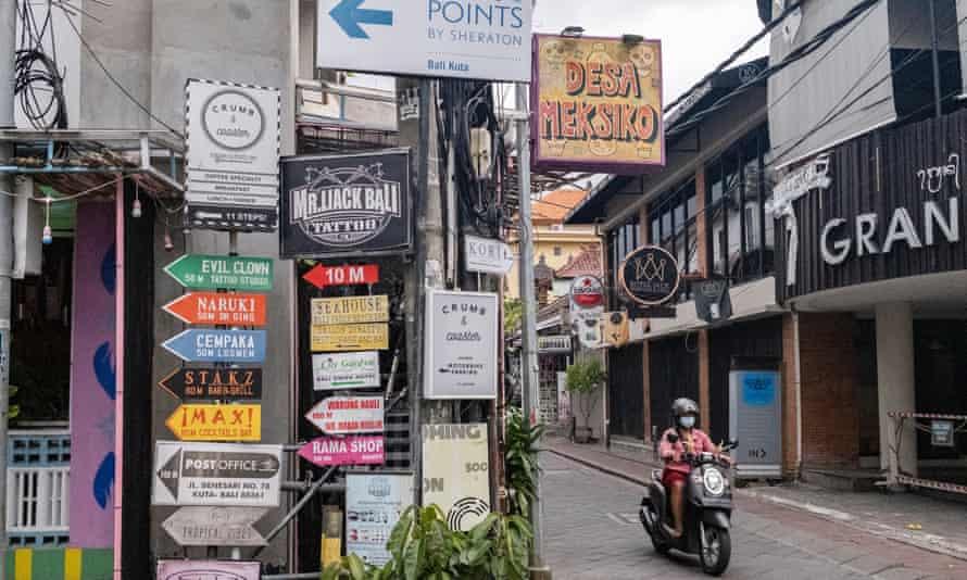 Person rides a motor bike in Bali
