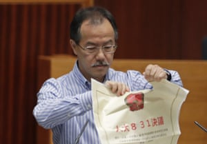 Newly elected pro-democracy lawmaker Fernando Cheung tore up a copy of controversial proposed anti-subversion legislation as he took the oath.
