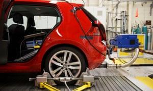 Car undergoing emissions test