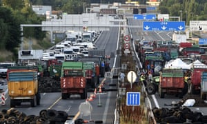 Farmers block the A6 motorway with tractors, farm trailers and tyres at the northern entrance to Lyon, one of the key arteries to southern regions.