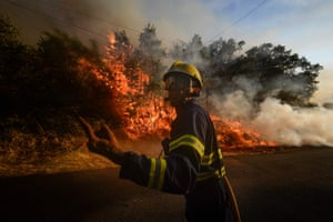 A firefighter works to extinguish a wildfire near Monterrey in San Cristobal, Spain