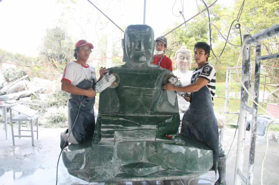 Workers carve the Jade Buddha in Thailand