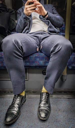 Passengers on London underground photographed by  Wolfgang Strassl.