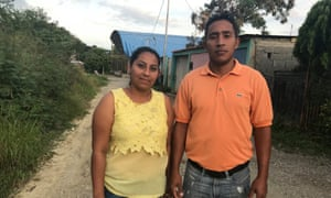 The parents of Victoria Martínez, Misael Martínez and Raquel Fuentes, outside their home in a shantytown in the Venezuelan city of Barquisimeto.