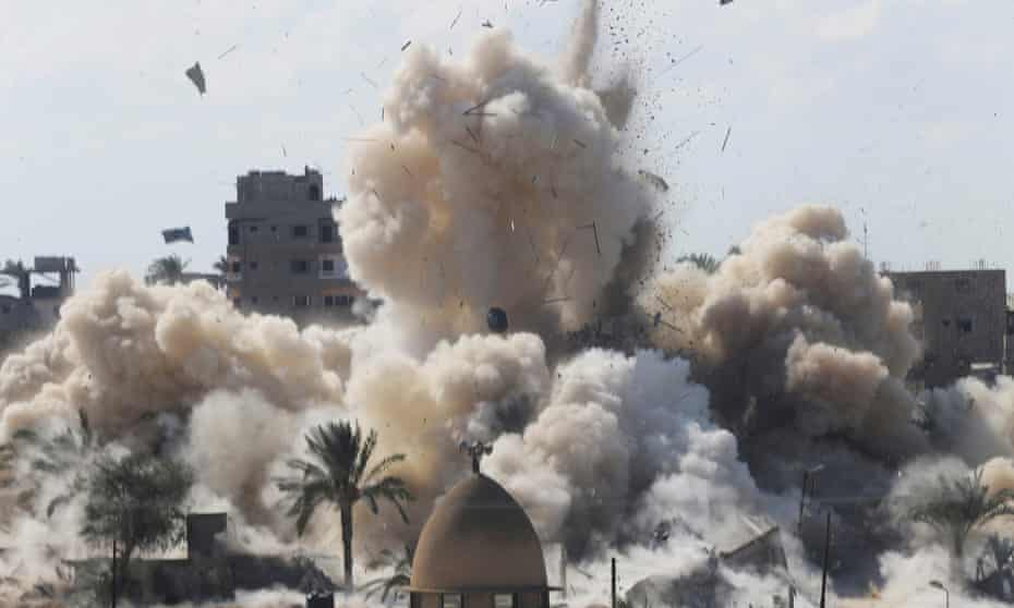 Smoke rises after a house was blown up during a military operation by Egyptian security forces in the Egyptian city of Rafah in 2014.