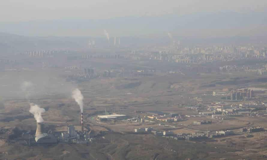Smoke and steam rise from towers at the coal-fired Urumqi power plant in Xinjiang, western China.