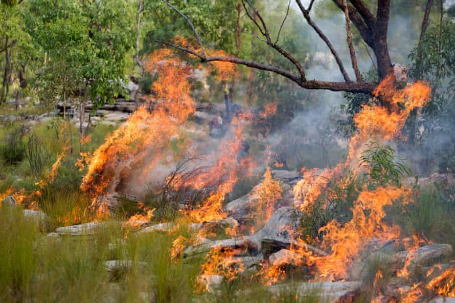 Rangers control a fire in the southern area of the Indigenous protected area, close to Kakadu