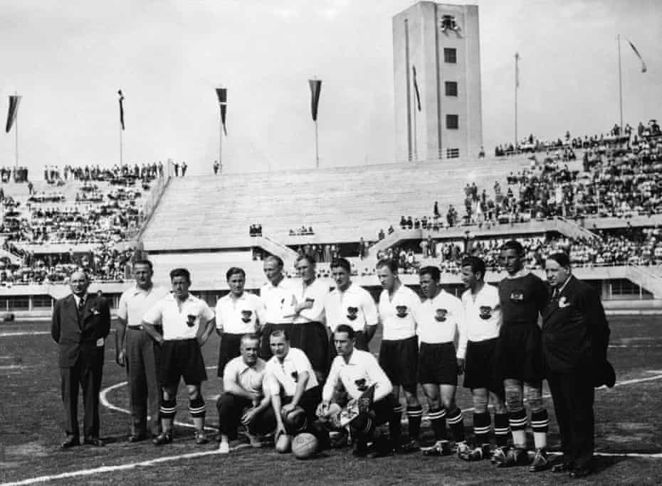 The Austrian players and staff, with Matthias Sindelar fifth left, line up ahead of their 3-2 extra time win over France in their first match at the 1934 World Cup.