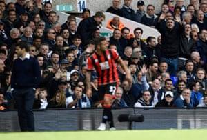 Tottenham fans look on as Jack Wilshere walks off.