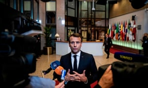 France's President Emmanuel Macron talks to journalists after the European Council meeting