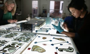 Fragments of glass from Westminster Abbey are inspected by Canterbury Cathedral's glass studio