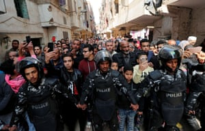 Police officers and members of the public in Cairo, Egypt, attend the funeral of Mahmoud Abou El Yazied, an officer who was killed in an explosion