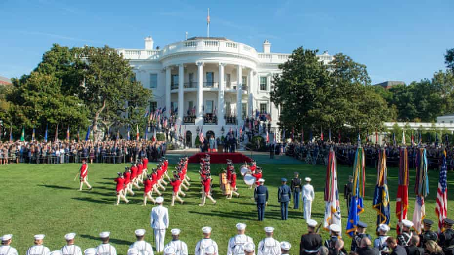 Donald and Melania Trump welcome Scott and Jenny Morrison on the south lawn with full military honours.