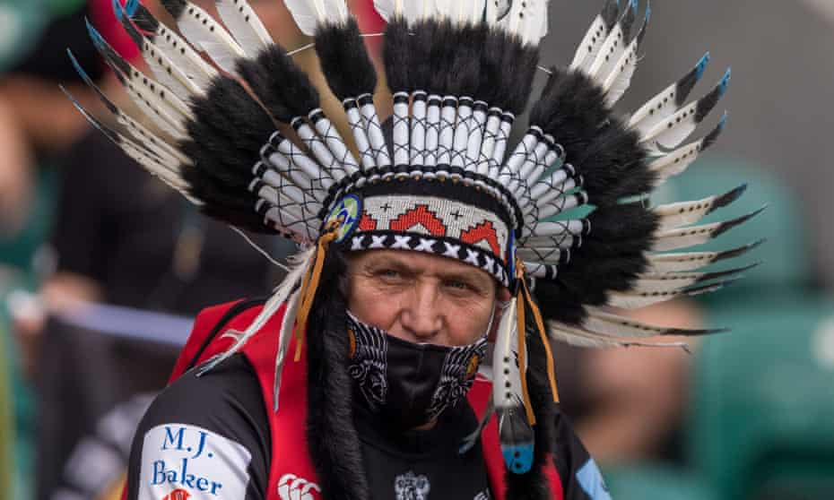 An Exeter Chiefs' fan wears a Native American headdress.