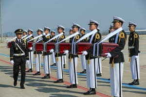 Incheon, South Korea South Korean troops carry coffins containing remains of martyrs of the Chinese People's Volunteers killed in the 1950-1953 Korean war, during a ceremony to mark the handover of the remains to China