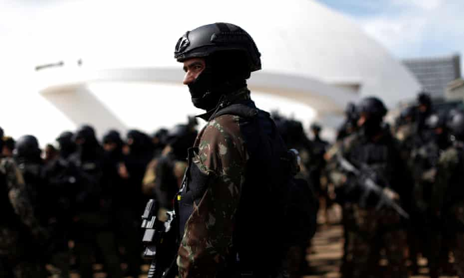 Brazilian soldiers carry out security preparations in Brasília before Tuesday's inauguration of Jair Bolsonaro.
