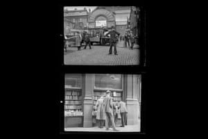 Londoners, c.1930, a Policeman directing traffic in market place and shoppers peering into a bookshop window, Charing cross Road, numbered negative images (2) £300-£500