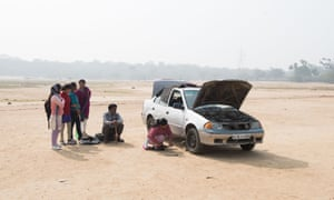 Pushpa changes a flat tyre as part of a driving workshop outside New Delhi.