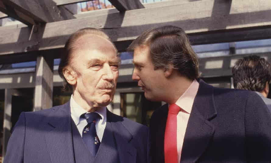 Donald Trump talks to his father in a photo from the 1980s.