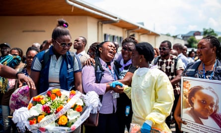 Family and colleagues of Belinda Kasongo, 30, who was part of the Ministry of Health vaccination team and was killed by armed men on 28 November 2019 in Biakato, attend her funeral at Goma´s cathedral on November 30, 2019.