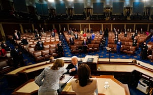 Fist bumps and elbow bumps were on display due to Covid concerns. A reduced number of lawmakers sat socially distanced from one another.