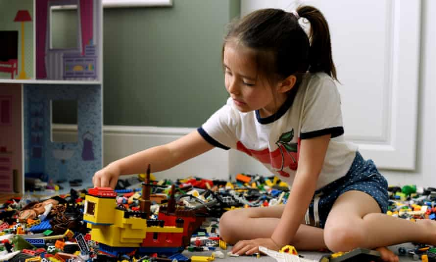 A child plays with Lego. The toymaker said it was working to remove gender bias from its product lines