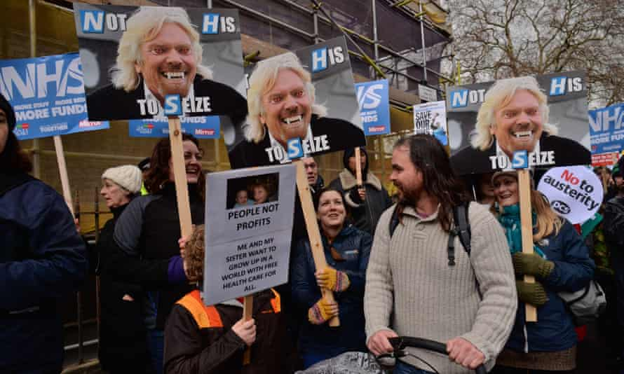 Demonstrators take part in an NHS protest demanding an end to the funding crisis in the Health Service.