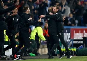 Manager Jan Siewert celebrates Mounie's late goal.