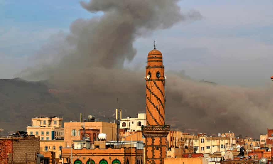 Smoke billows following an airstrike on Tuesday by Saudi-led coalition forces in the Yemeni capital, Sana'a