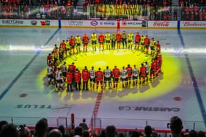 Calgary Flames and Vegas Golden Knights players stand during the moment of silence for the Humboldt Broncos in Calgary on Saturday.
