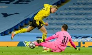 Erling Haaland of Borussia Dortmund is denied by goalkeeper Ederson of Manchester City.