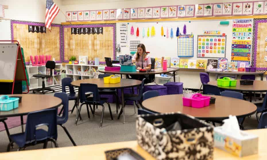 A teacher virtually teaches a first-grade class last August in Tempe, Arizona.