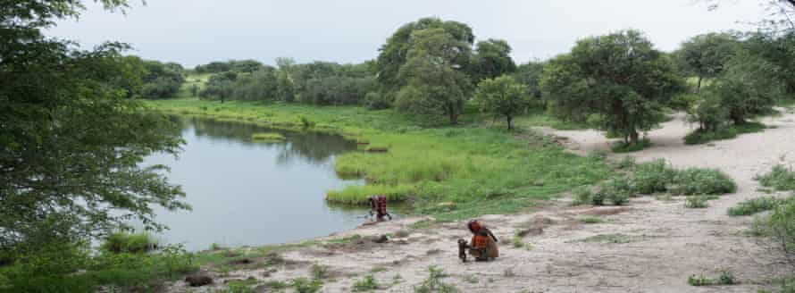 CHAD. August 2017. Outskirt of Bol. Two women on the shores of Lake Chad.