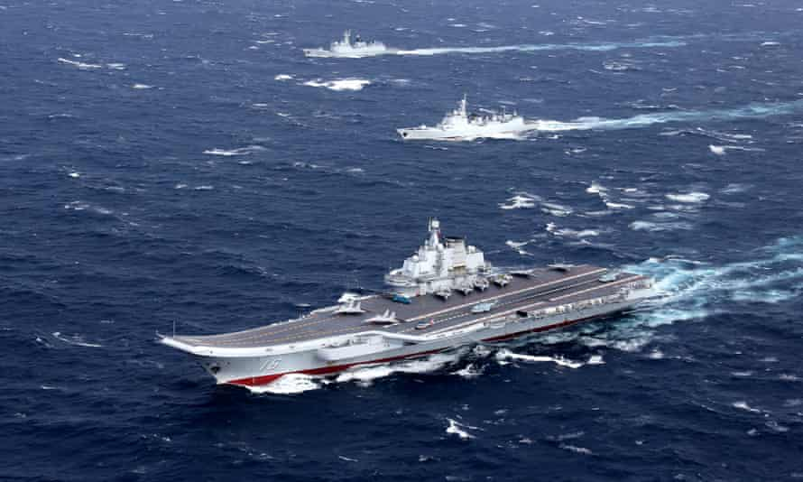 China's Liaoning aircraft carrier conducts a drill in the South China Sea. State media has warned of conflict if the US attempts to block access to islands there.