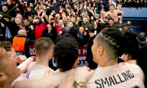 Manchester United fans celebrate with the team