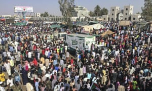 Sudanese protesters march with national flags